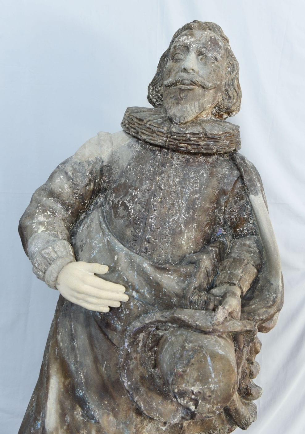 During replacing of missing stone hand, nose and cloak details following research