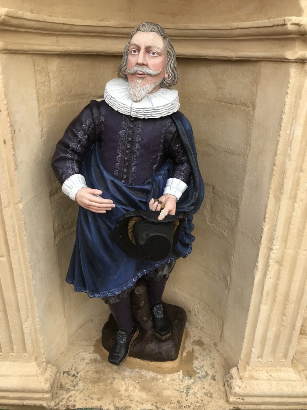 Installed polychrome sandstone statue of John Cowane in the same position as before dismantled.